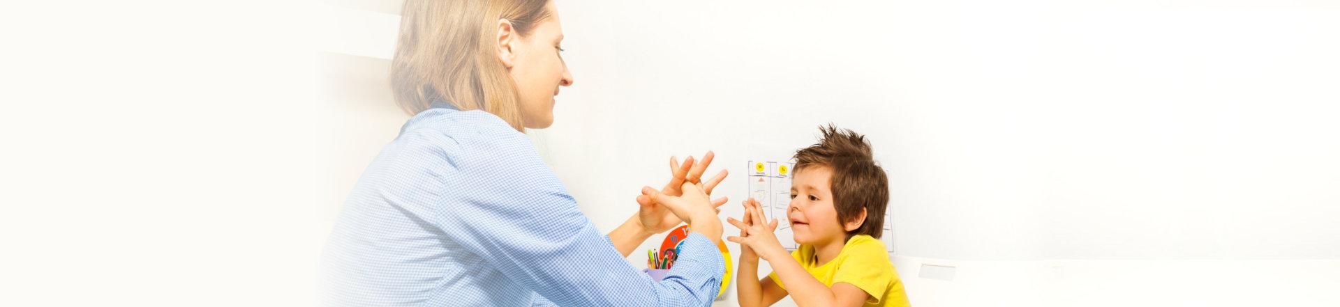 woman teaching the child